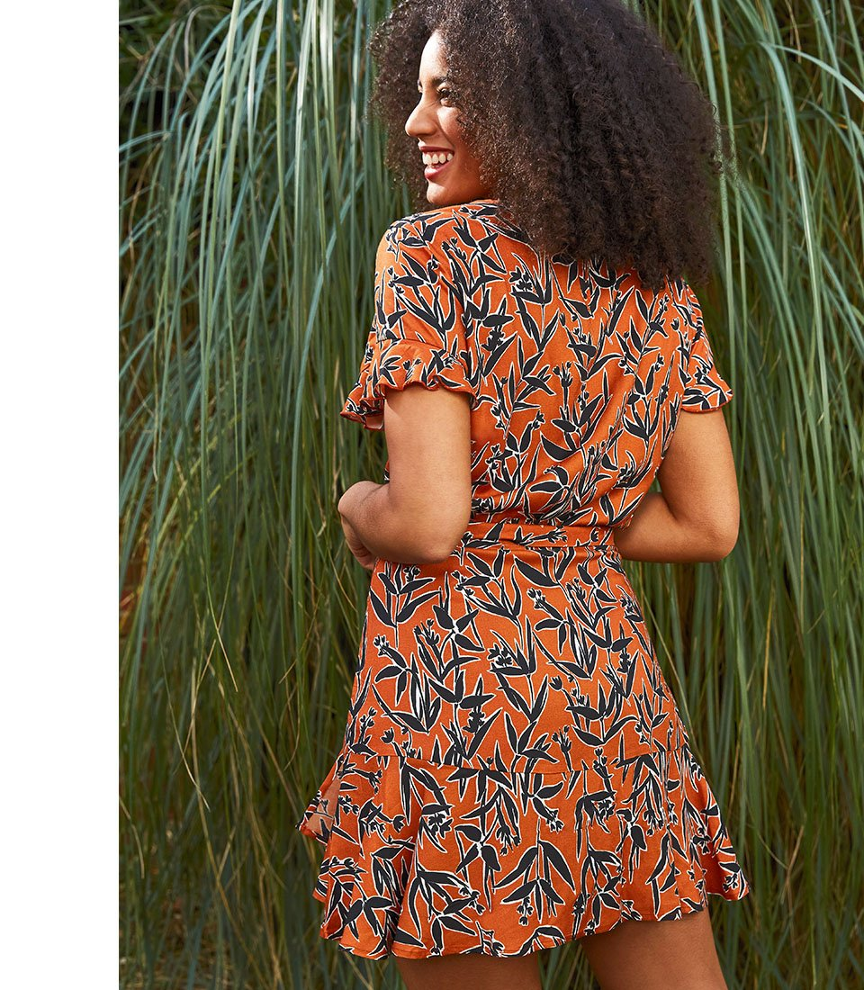Shop Indiana Ruffle Dress Black & Rust Floral and more