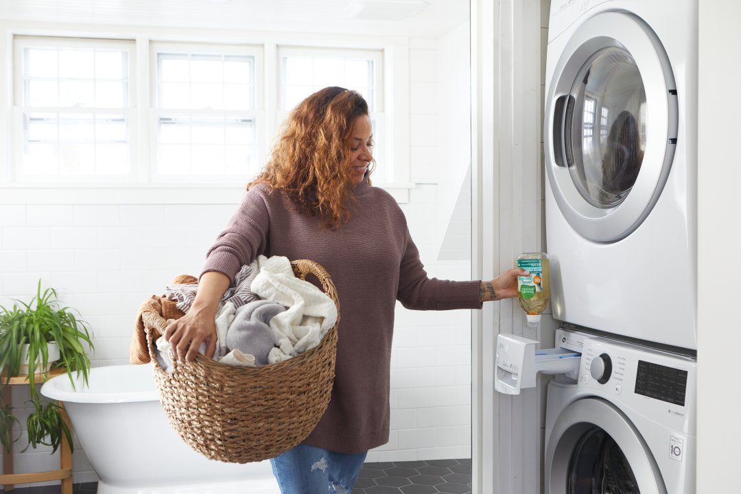 person doing laundry with EasyDose