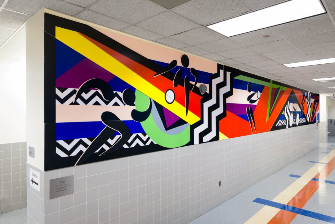 colorful art on a highschool white wall