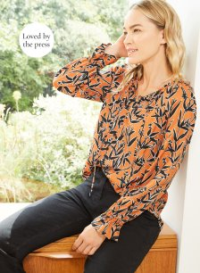 Shop Indiana Blouse Black & Rust Floral and more