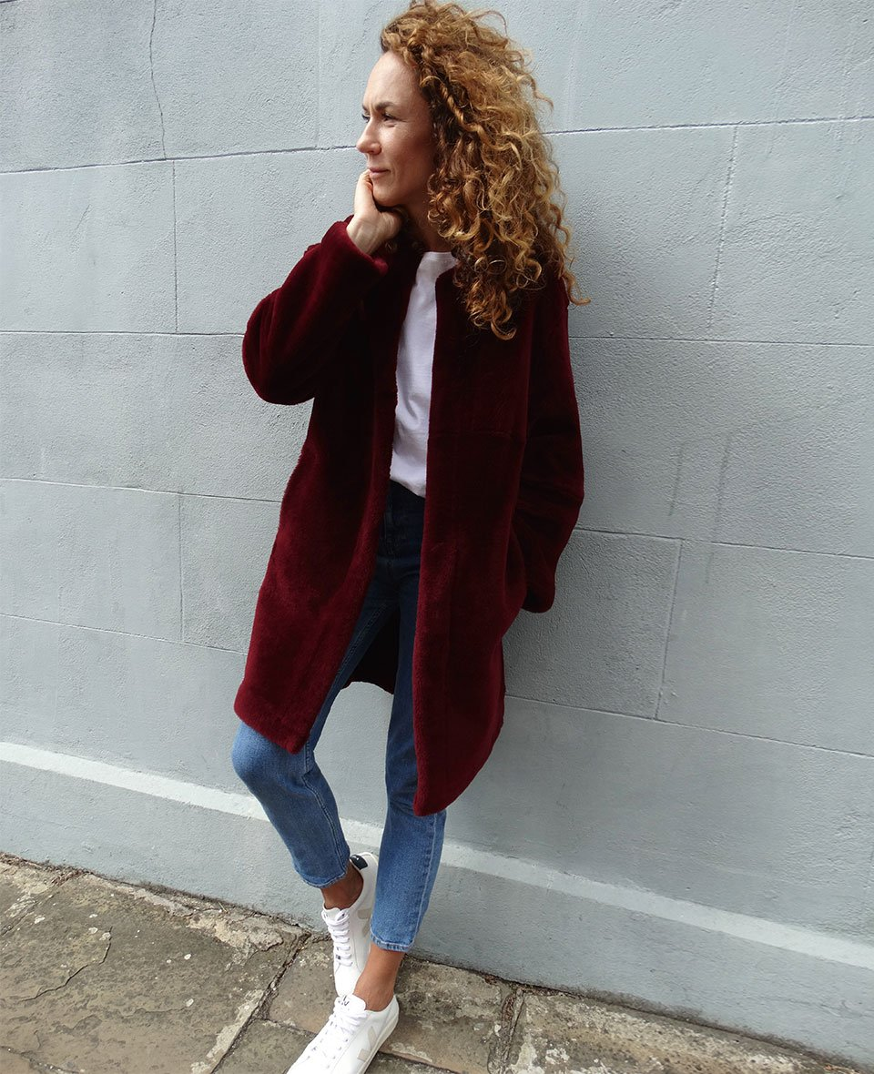 Shop The Shearling Coat Redwood, The Girlfriend Jean Washed Blue and more
